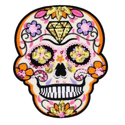 grafika czaszka wykonana z cekinów